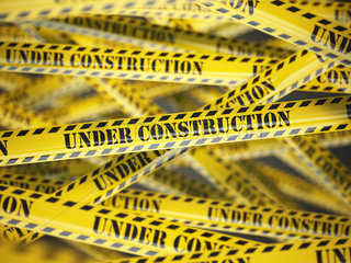 Under construction yellow caution tape background.