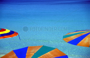 Multi-colored umbrellas in the sea