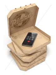 Mobile pizza ordering and delivery concept. Smartphone and pizza boxes isolated on white.