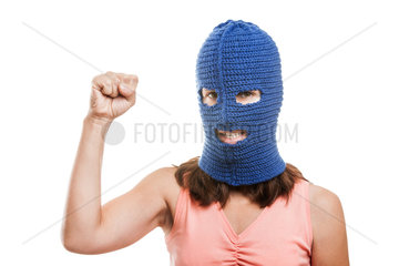 Woman in balaclava showing raised fist gesture