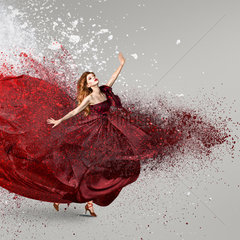 Woman dancing with cloud of powder