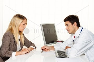 Doctors interview Patient and doctor talking at a doctor's office