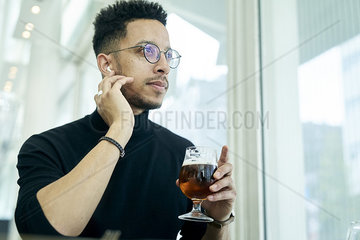 Thoughtful businessman having drink