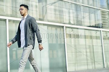 Businessman walking outside office