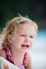 Outdoor portrait of crying toddler girl