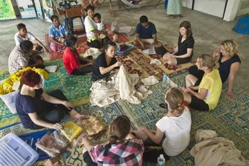 Volunteers learn how to TIE DYE during a home stay at Ben Lion  build by the Lion's Club of Thailand on KOH PHRA THONG ISLAND after the Tsunami of 2004