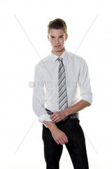 A young succesful man rolls up his sleeves