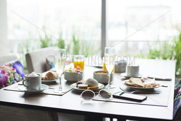 Breakfast and champagne on table in cafe