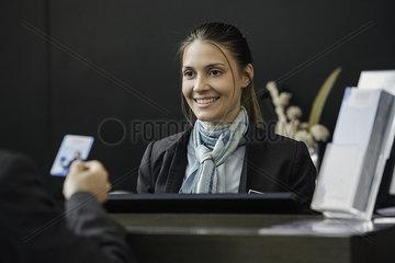Bank teller helping customer