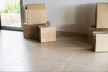 Cardboard boxes in empty living room