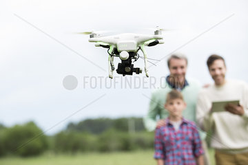Family playing with drone