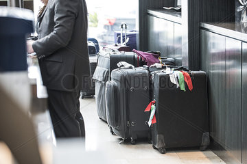 Suitcases behind hotel reception counter
