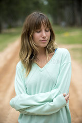 Young woman outdoors with eyes closed  portrait