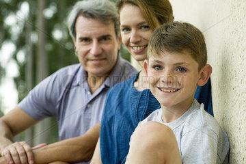 Boy with parents  portrait