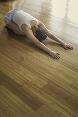 Woman practicing yoga childs post