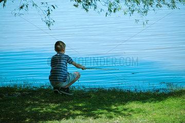 Boy fishing  rear view