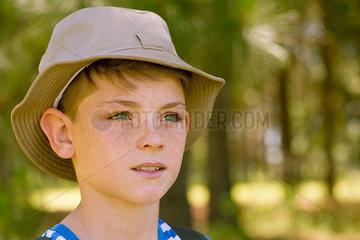 Preteen boy looking into distance