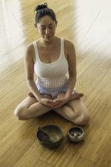 Woman sitting on floor meditating