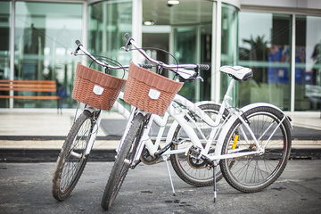 Pair of bicycles parked in front of building