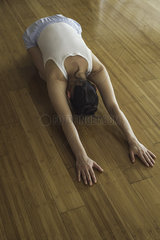 Woman practicing yoga childs pose