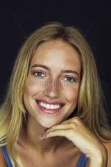 Young woman smiling cheerfully  portrait