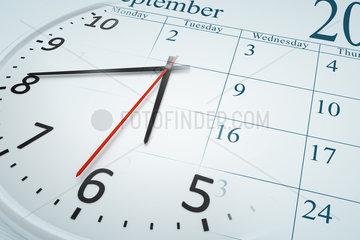 a composite of a clock and a calendar