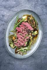 Sliced Point Steak with Thai Vegetable on Plate