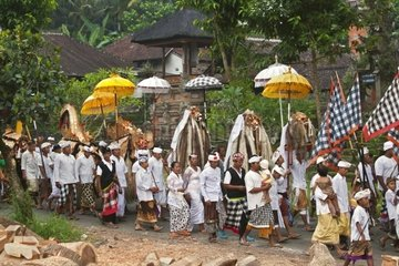 A BARONG COSTUME and LION MASKS used in traditional LEGONG dancing are carried during a HINDU PROCESSION for a temple anniversary