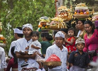 Women bring offerings of frut  flowers and pastries to the PURA TIRTA EMPUL TEMPLE COMPLEX during the GALUNGAN FESTIVAL