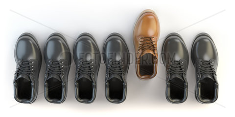 One unique brown boot in the row of black boots. Marketing concept. Choosing the style  Think different.