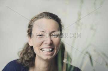 young happy woman smiles at the viewer
