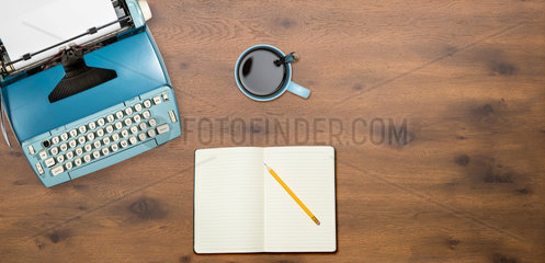 Old electric typewriter on wood background