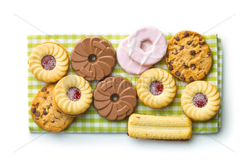 Various sweet biscuits on checkered napkin.