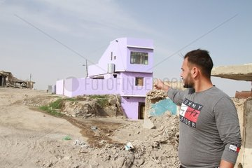 IRAQ-MOSUL-1ST HOUSE AMONG RUBBLE