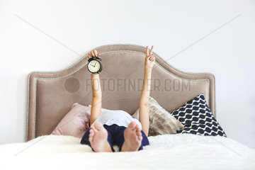 Pregnant woman indoors sitting on the bed