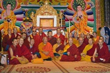 TIBETAN MONKS participate in a Dalai Lama teaching sponsored by the TIBETAN MONGOLIAN CULTURAL CENTER