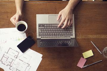 Man at work using laptop