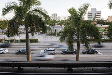 Traffic moving on city street