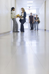 High school students talking in school corridor