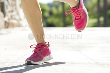 Woman jogging in sports shoes  cropped