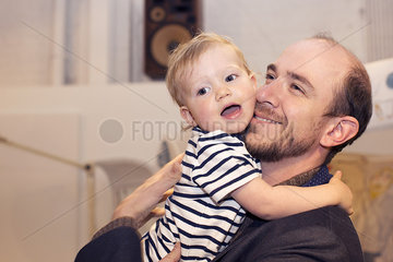 Toddler hugging father