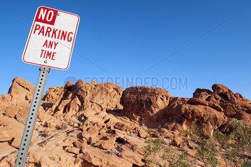 No parking sign in desert