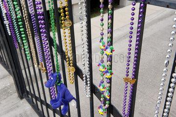 Mardi gras beads hanging on railing in New Orleans  Louisiana  USA
