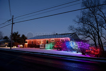 House decorated with colorful Christmas lights