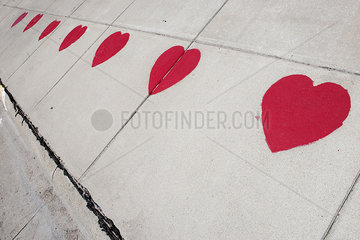 Hearts stenciled on sidewalk