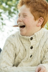 Father and son laughing together outdoors