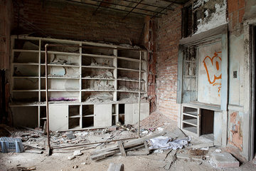 Rubble and graffiti in abandoned  deteriorating building