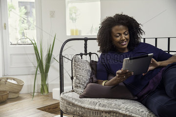 Woman connecting to social media using digital tablet