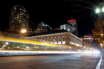 Light trails from traffic on city street at night