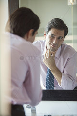 Man gazing at his reflection in mirror